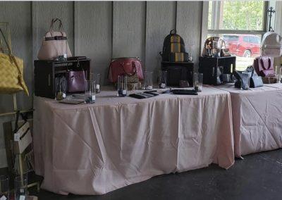 Luxury purses on display for raffle.